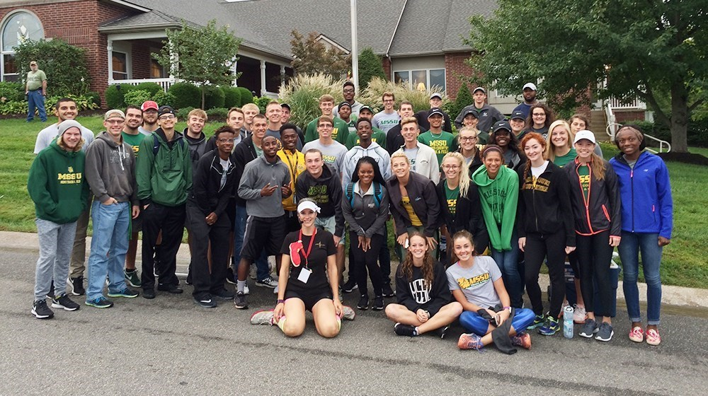 Track and Field and Men's Basketball Lend A Helping Hand