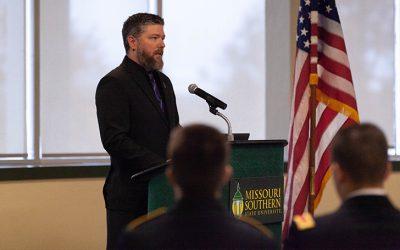 Former student Brodi Pursley speaks at Veterans Day event
